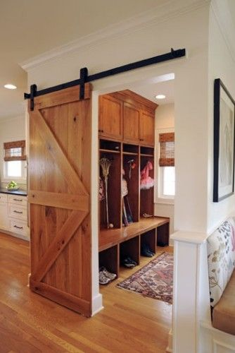 wooden sliding barn door with arrow styling