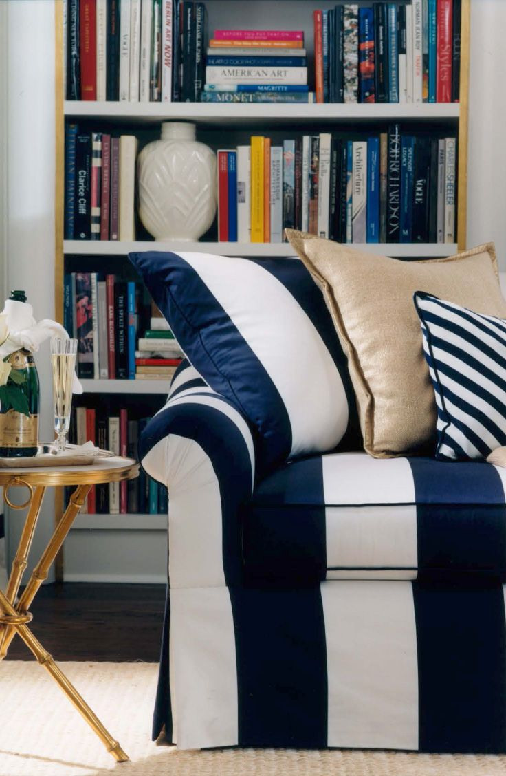 A blue and white striped Bel Air sofa is bold in an elegant suite on the Riviera by Ralph Lauren Home