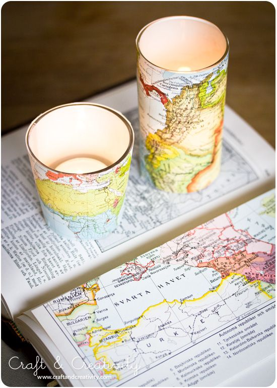 paper candle holders made out of old books & maps- wrapped the paper around small drinking glasses and and secured with tape