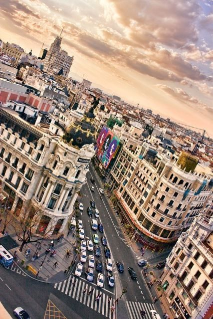 Gran Vía, Madrid. (Spain)  I stayed in Madrid in late 90s for a couple of days.  Would love to stay there for longer!  Such a fun city!