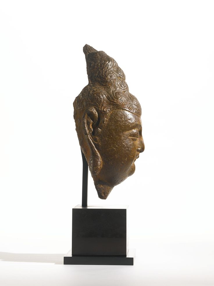 A STONE HEAD OF A BODHISATTVA<br>CHINA, TANG DYNASTY | Lot | Sotheby's