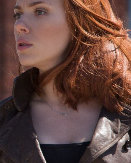 Photo of Natasha wearing a little arrow necklace.