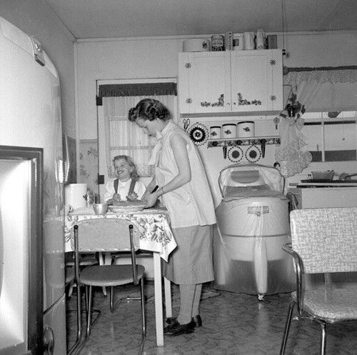 Domestic life, 1950s. Washing machine, Refrigerator. We had one of those machines, but it was in the basement. Mom would wash the clothes and then hand them on the line. They have a smell in a bottle that will equal that.