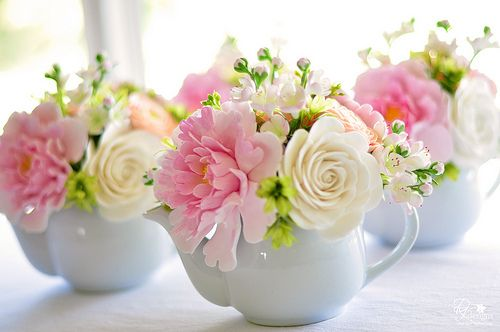 Pretty teapot flower arrangements , great for a baby shower or kitchen tea| Diane Phillips, dkdesigns, via Flickr