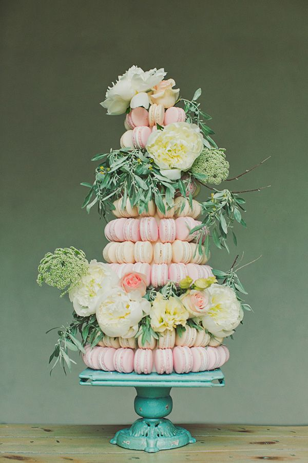 Macaron cake adorned with peonies and olive branches
