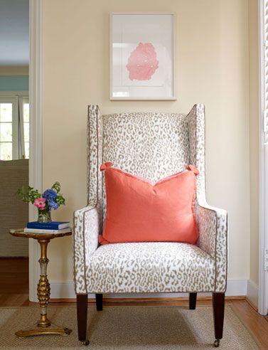 leopard print chair with nailhead + coral pillow