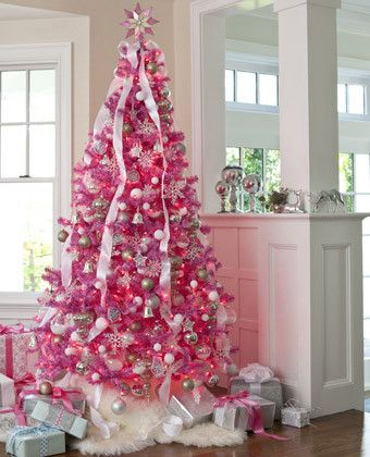 #6 Mod Pink #Christmas Tree- This attention-grabbing hot pink tree feels like a winter wonderland when embellished with silver and white ornaments.