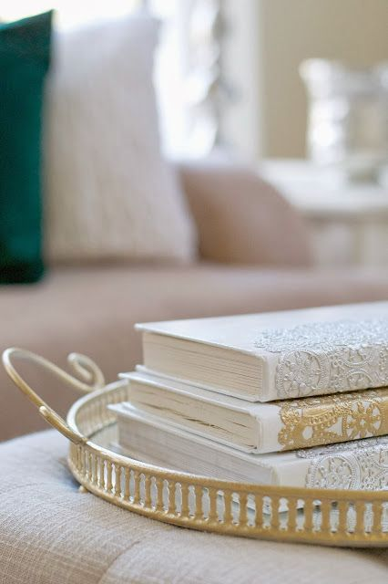 "I like her attitude and philosophy about decorating.   ""Progress over perfection."" There are several good ideas in here.   I'll be pinning a couple,  including this metallic doily book cover.   [50 Budget Decorating Tips]"