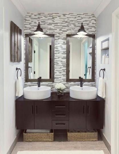 Beautiful vanity area! Love those vessel sinks and the crisp look against the dark wood!