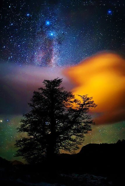 Milky way an cloud enlightened by the sun.  El Chalten, Patagonia, Argentina.
