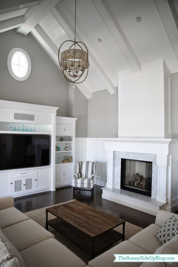 Built-in entertainment center and bookcases. Fireplace. Lots to like here, from the layout to the cathedral ceiling. Family room space.