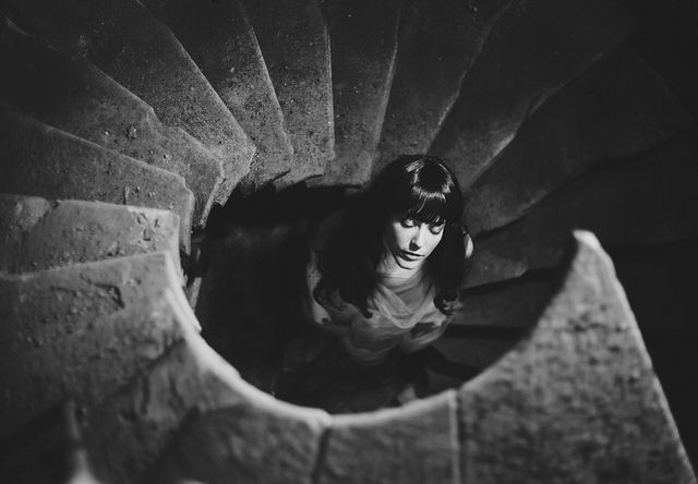 Woman Standing in Center of Staircase