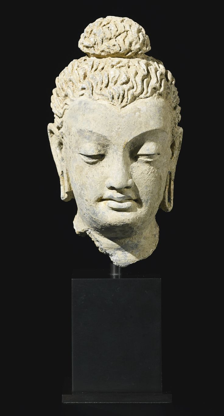 A terracotta head of Buddha, Ancient region of Gandhara, Kushan period, 4th-5th century