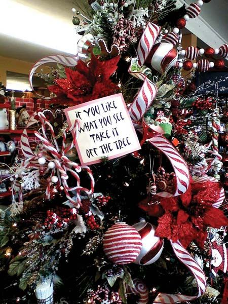 Great sign instructing customers to take the ornament off the tree to buy it if they like it! GIFT SHOP Magazine
