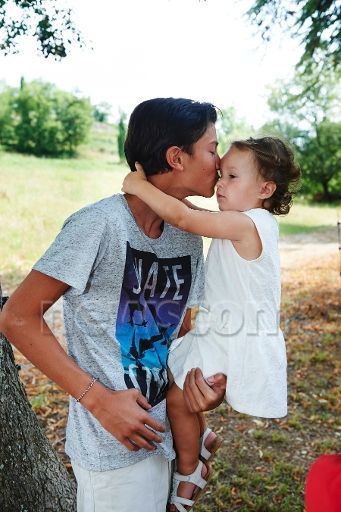 princessofsuffolk:  Prince Joachim and family vacation in Cayx, France, July 2014-Prince Nikolai giving his little sister Princess Athena a kiss
