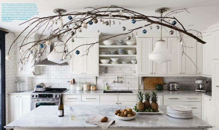 Branch hung w/ Christmas balls over the island - like this look, and the kitchen too!