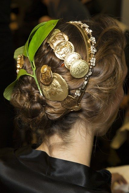 "From the back, hairstyles were accessorized with coins, jewels and even leaves, in keeping with the ""ancient"" theme of the collection"