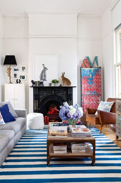 Dark fireplace and mantle, white walls, and rabbits...Image Via: Lea