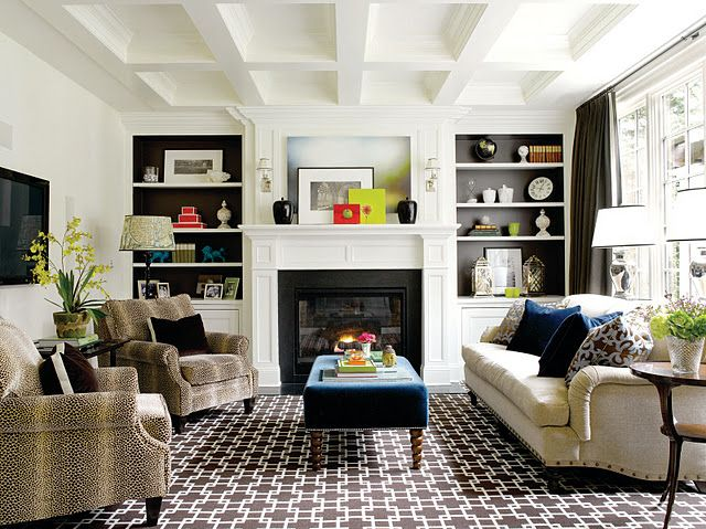 paint the insets of the built-ins with a contrasting color that coordinates with your design scheme