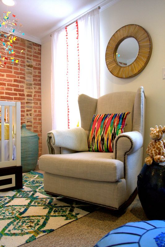 We love this modern, gorgeous nailhead @potterybarnkids glider in this eclectic nursery!