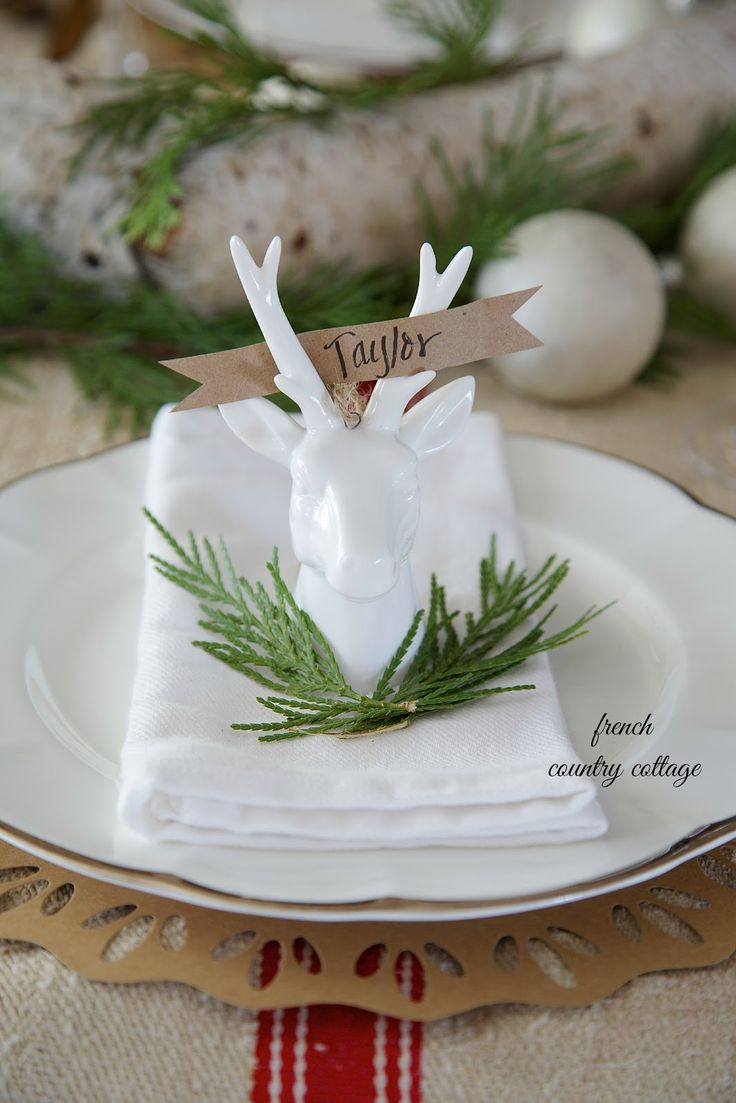 Super cute idea for using ornaments on the dinner table from FRENCH COUNTRY COTTAGE: Reindeer place card holders #christmas #tablescape
