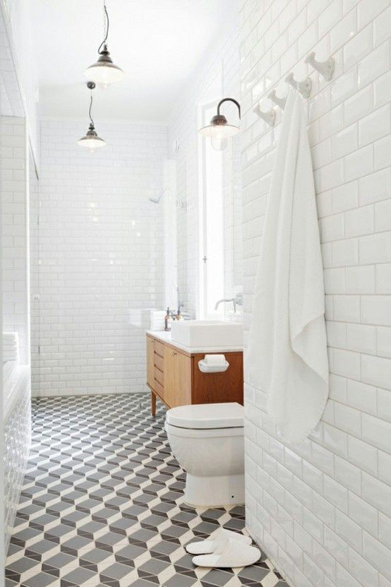 bathroom- subway tiles, wooden cabinet and maybe retro floor