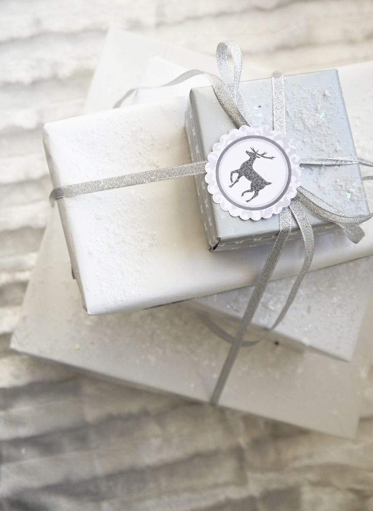Packaging White Xmas.  I would do all one color (ex. Red, Green, White) with different textures of paper and ribbon.