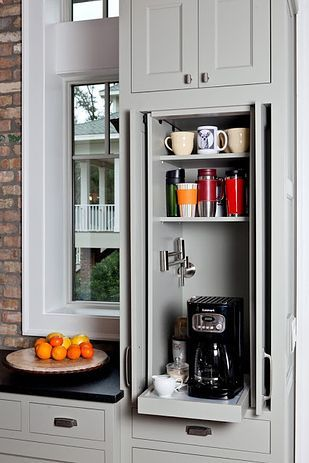 Hide a slide-out coffee bar or kitchen appliances behind folding doors.