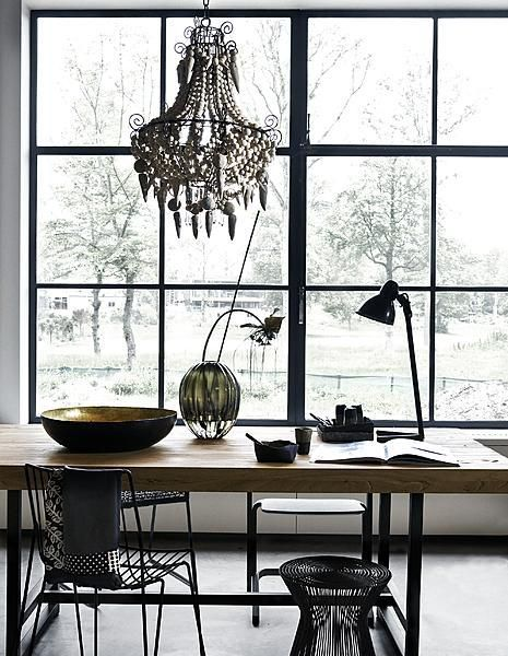 Black chandelier, chair, stool and desk lamp