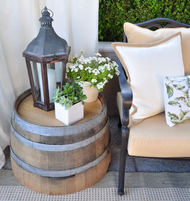 The side tables are halves of wine barrels simply turned upside down. Find them at a local hardware store for $20.