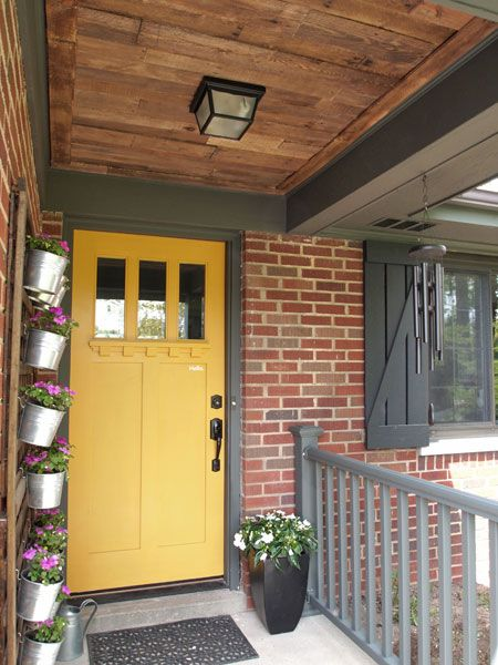 Front Porch Pallet Wood Ceiling & cheery yellow door