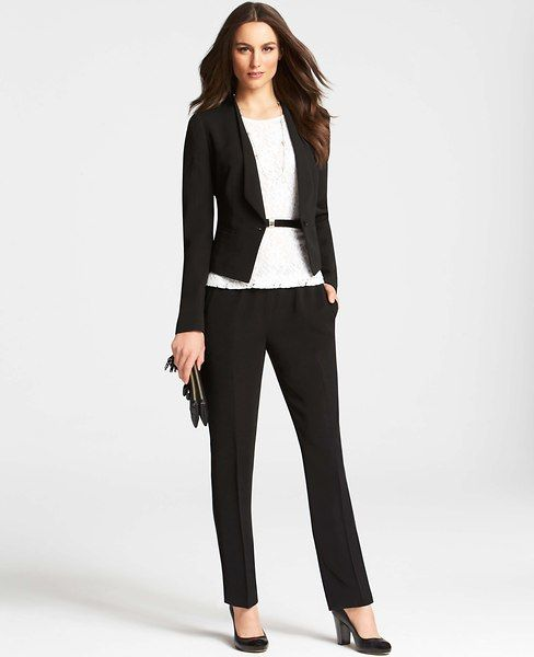 Standard interview outfit. Conservative, fitting, and professional. Don't be afraid to add some color, but take it easy on make-up, jewelry, and other accessories.