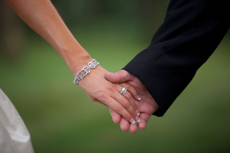 Image result for bride and groom holding hands