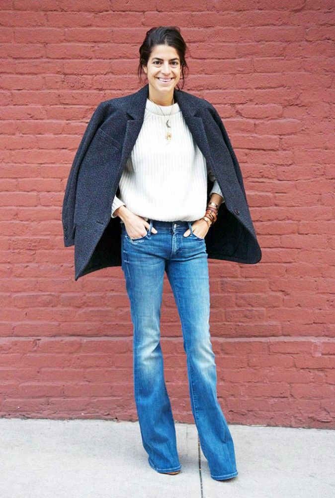 Go cozy like Leandra Medine of Man Repeller in flared jeans, chunky knits, and delicate jewelry.