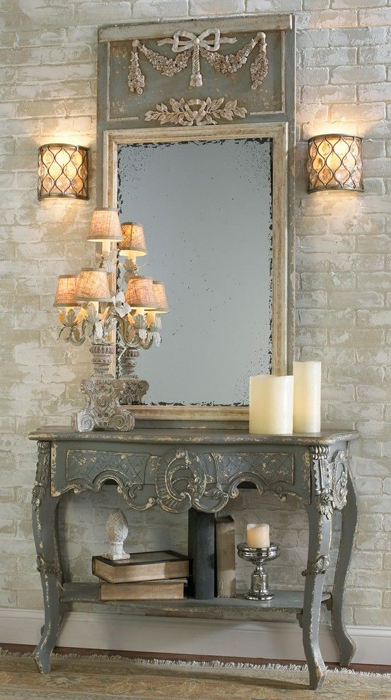 I really like this, I think the top piece with the bow and such is a little much, though, I would leave it with just the cream framed mirror.