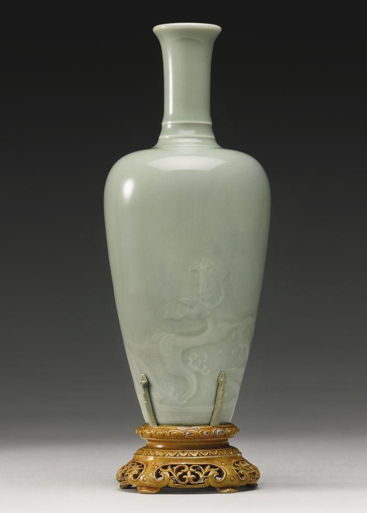 A fine and rare celadon-glazed 'Dragon' vase, Kangxi mark and period