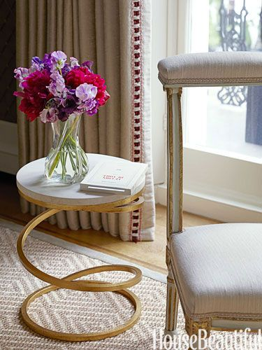 Pretty blooms on a spiral-base table by Mrs. MacDougall from Donghia.