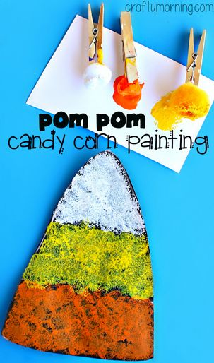 Candy Corn Craft using Pom Poms to Paint #Halloween craft for kids to make! #Fall | CraftyMorning.com