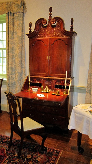 Winterthur in Delaware contains some of the moat refined examples of Federal Period architecture and furnishings. This sublime mahogany secretary is crowned with a curved bonnet and lovely finials. What a wonderful place to pen a letter.