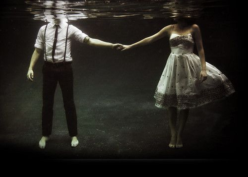 Couple Holding Hands Underwater