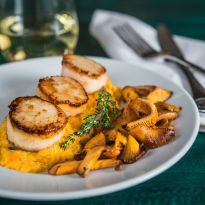 Seared Scallops with Sweet Potato Grits and Chanterelle Mushrooms