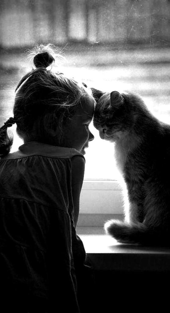 Black and White photo of little girl and cat