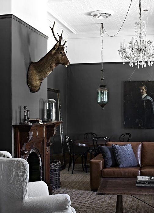 Masculine decor & feminine crystal chandelier: beautiful contrast