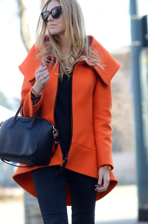 great graphic contrast. black with a bright orange. love the cat eye sunglasses.