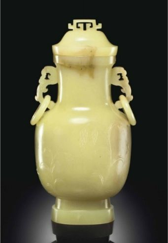 A Rare Yellow And Pale Brown Jade Vase And Cover, Qianlong-Jiaqing period (1736-1820). Estimate: $300,000 - 500,000 Price Realized: $581,000