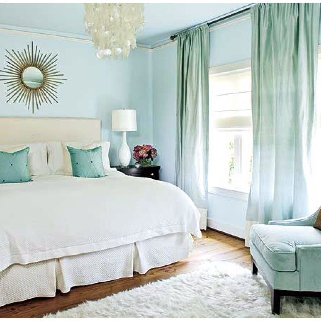 5 Calming Bedroom Design Ideas. I love the colors and that mirror.
