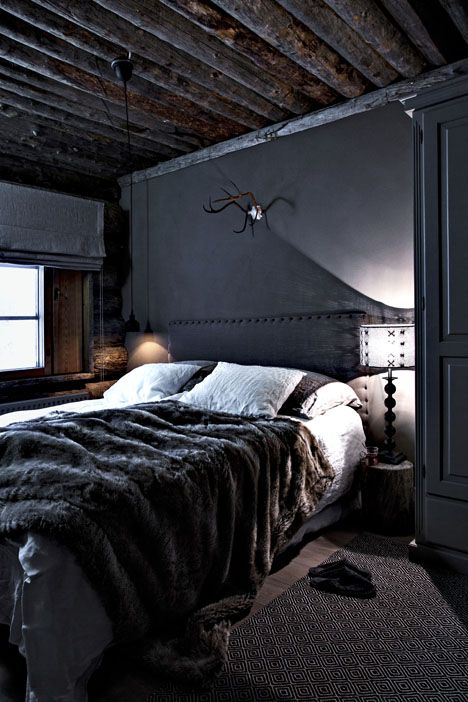 rustic dark interior design bedroom. How to do my black/white/grey color scheme with lacquer lamps, silver accents, black furniture, mirrored furniture, shimmery black or grey rugs, grey velvet headboard and slipper chair. Black painted walls can actually work in a rustic log cabin bedroom. Dark hard wood floors, wood beams stained dark on ceiling, black door, & black painted walls. Maybe a black bear rug. Or grey animal rug. (No antlers above bed though)