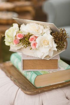 Book overflowing with flowers.   Photography by Kim Le Photography
