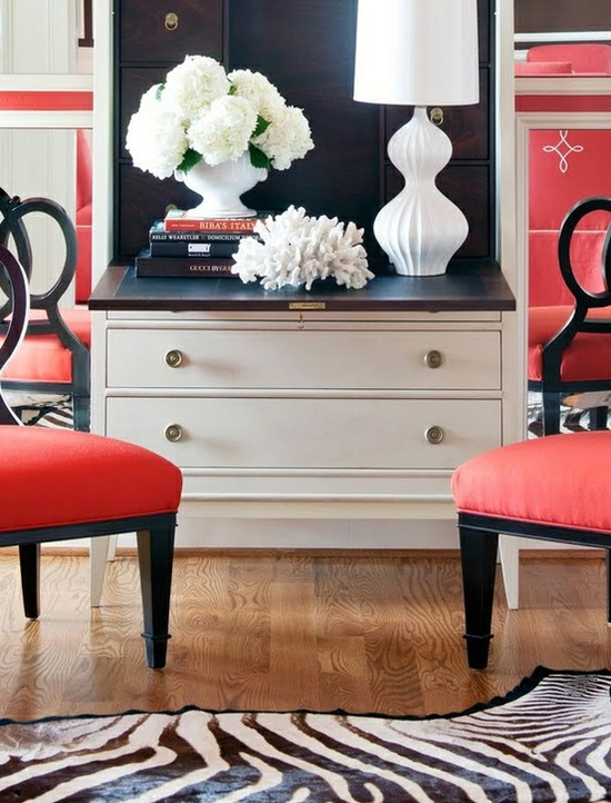 Adore the coral and lamp. Those chairs look jazzy, but I'm not a big fan of red; easy to switch up either way!