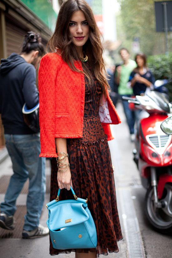 Street Style Spring 2013: Milan Fashion Week Disparate elements of leopard, turquoise and red come together effortlessly here.